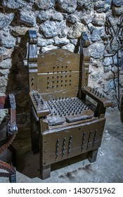 Medieval Chair with metal spikes for torture