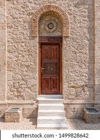 medieval church arched wooden door and stone wall
