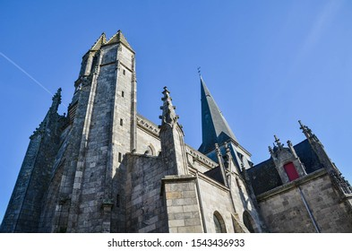 Medieval church in France on a blue sky background photographed from the below
