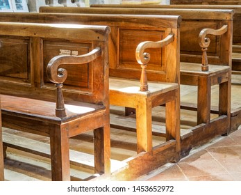 Medieval church pews with sunlight