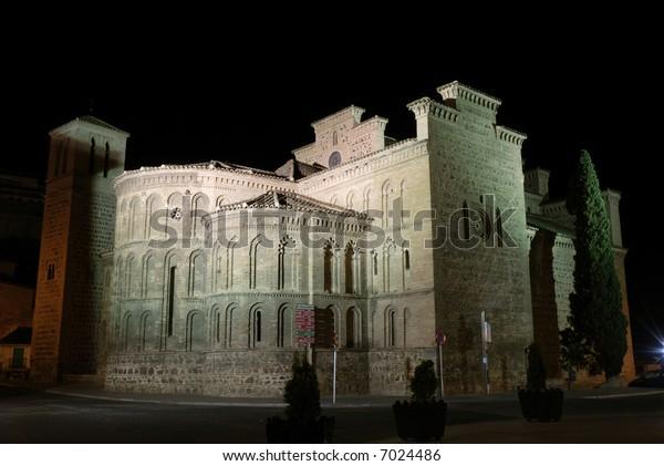 Medieval church in Toledo illuminated at night, Spain
