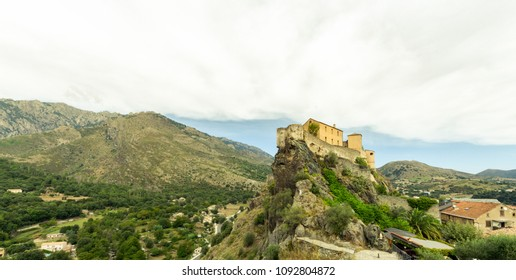 Medieval Citadel In Corte, A City In The Mountains, France, The Island Of Corsica. Beautiful City Landscape