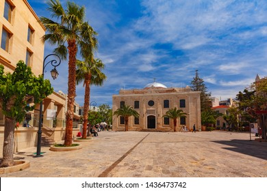 The medieval city with Basilica of St Titus, the Patron Saint of Crete during the medieval times, in the sunny morning, Heraklion, Crete, Greece