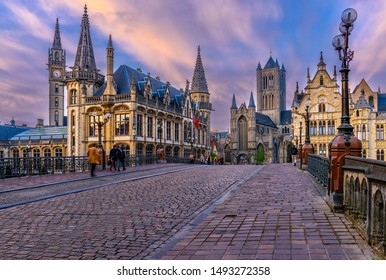 Medieval city of Gent (Ghent) in Flanders with Saint Nicholas Church and Gent Town Hall, Belgium. Sunset cityscape of Gent.