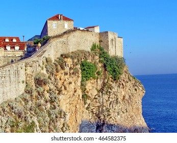 Medieval city walls around Dubrovnik, Croatia, with the Adriatic Sea below