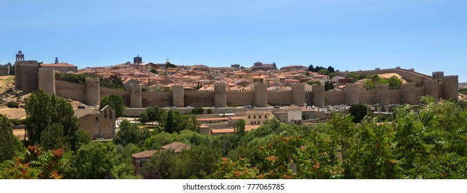 The medieval city walls and the city of Avila in the Castilla-y-Leon region of central Spain.