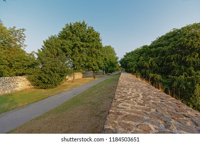 Medieval city walls with walking path and trees of Boulogne sur Mer, Oise, France, view from above on a sunny morning