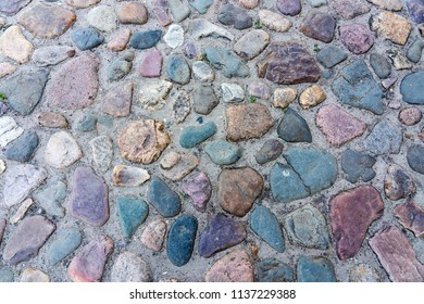Medieval cobbles asphalt. Stone pavement texture. Cobblestone pavement. Cobbles texture - hard pavement.