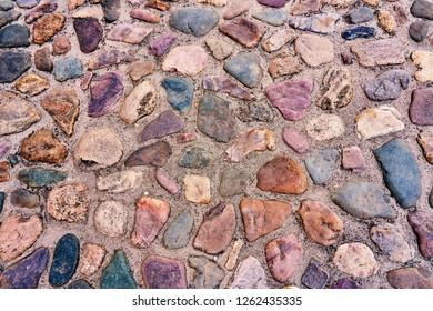 Medieval cobbles asphalt. Stone pavement texture. Cobblestone pavement. Cobbles texture - hard pavement.