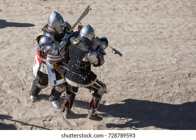 Medieval combat between armed and uniformed men with armor of the time in the 14th and 15th centuries.