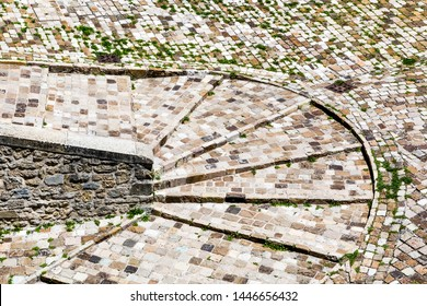 Medieval curved stone path made of cobble stones. Ancient road with very narrow curve.