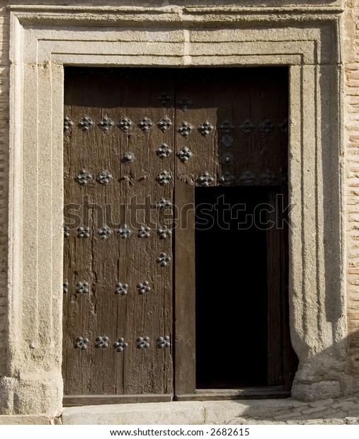 Medieval door on a building in Toledo, Spain