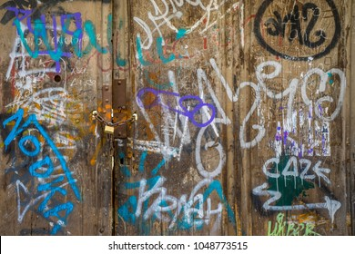 medieval door Spanish city of Segovia. Old metal entrance. ancient architecture, grafitti
