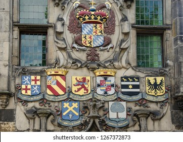 Medieval Dutch blazons on a building in Delft