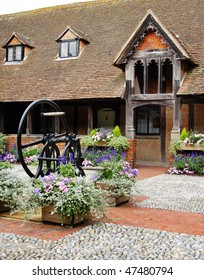 A Medieval English Cobbled Courtyard garden and  Alms Houses with Well and cloister