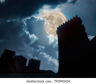 Medieval european castle in a cloudy full moon night. Added some digital noise.