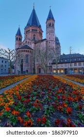 Medieval european church with flowerbed outside. Mainz. Germany