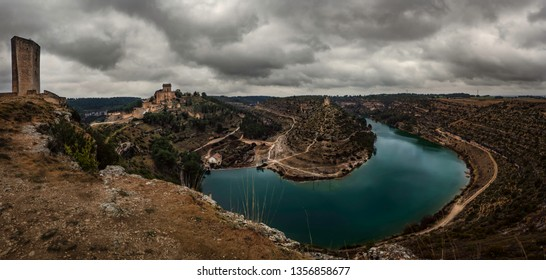 Medieval european landscape with castles and river on cloudy day color