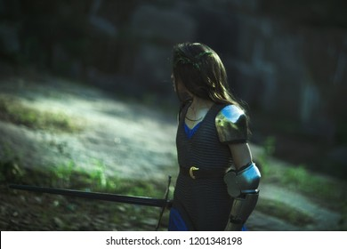 a medieval female knight in armor