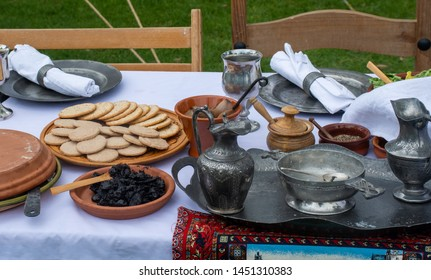 Medieval food table with biscuits and pewter