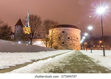 Medieval fortification tower with church on background