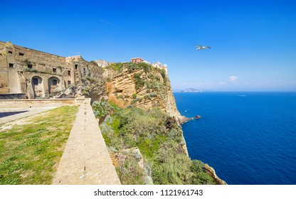 Medieval fortifications, blue Gulf of Naples at Procida. Old historical fortified center of Terra Murata situated on highest point of island Procida, Naples, Italy.