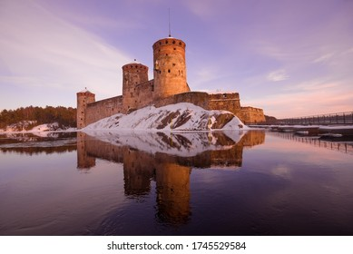 The medieval fortress of Olavinlinna on a sunny March evening. Savonlinna, Finland