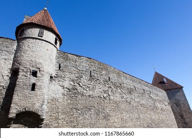 Medieval fortress with towers in the Old town. Tallinn, Estonia. The towers have a red tiled roof