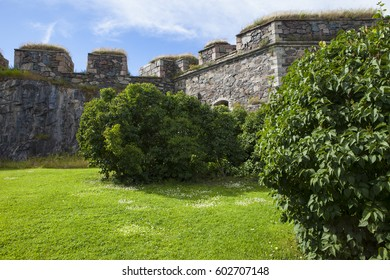 Medieval fortress wall and the lawn around