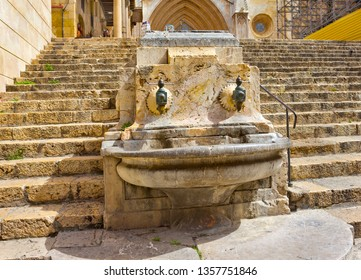 Medieval fountain on the street near the cathedral in Tarragona, Spain