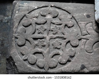 Medieval fragment of a grave slab bearing a foliated cross, on display in Chester Cathedral's cloister walk. City of Chester, Cheshire, UK