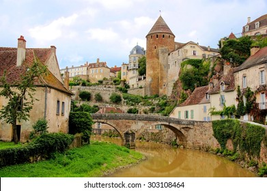Medieval French village of Semur en Auxois, with old stone bridge Burgundy