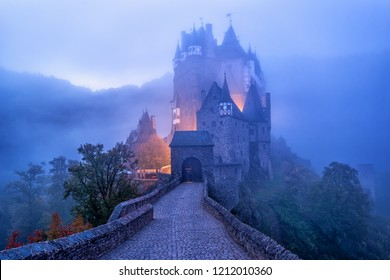 The medieval gothic Burg Eltz castle in the morning mist, Germany. Eltz Castle is one of the most impressive and famous castles in Germany.