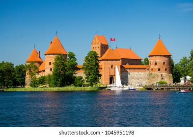 Medieval gothic Trakai Island Castle with stone walls and towers with red tiled roofs in Lake Galve, Lithuania