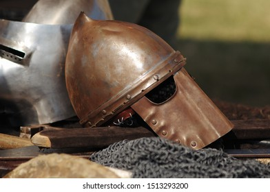 Medieval helmet. Medieval armour metallic fabric. Sword.