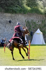 """Medieval horseman. Knight on horseback. Festival """"Tallinn Old Town Days"""" - mounted knights tournament. Reconstruction of knight tournaments of the Middle Ages. Tallinn, Estonia."""