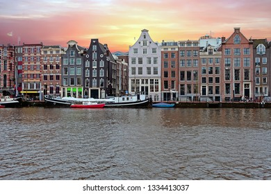 Medieval houses along the river Amstel in Amsterdam Netherlands