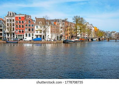 Medieval houses along the river Amstel in Amsterdam the Netherlands