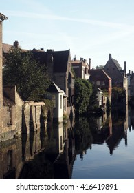 medieval houses on canal historic Bruges Brugge Belgium Europe