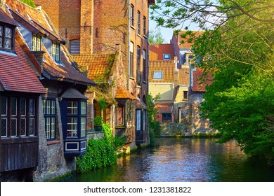 Medieval houses over canal in Bruges Belgium landscape panorama with vintage architecture.