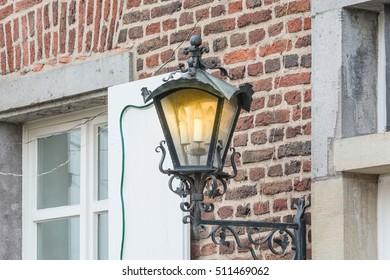 Medieval illuminated street lantern made of wrought iron.