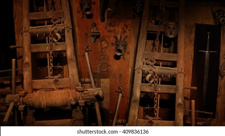 Medieval inquisition equipment on the wall of gothic dungeon.