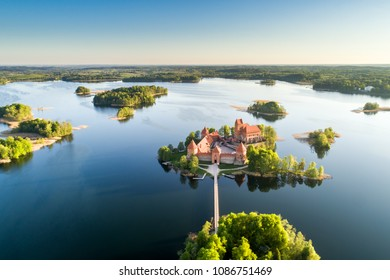 Medieval island castle in Trakai at Galves lake in early morning taken from drone.