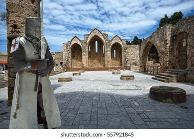 Medieval knight in ruins of the Church of the Virgin of the Burgh in the Old Town of Rhodes, Greece