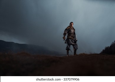 Medieval knight with sword in armor as style Game of Thrones in Winter Landscapes