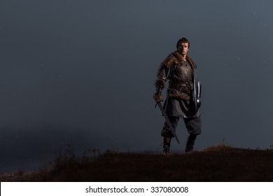 Medieval knight with sword in armor as style Game of Thrones in Winter Rock Landscapes