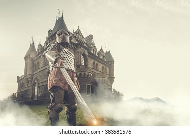 Medieval knight with the sword on the ancient castle background. Low contrast post processing.