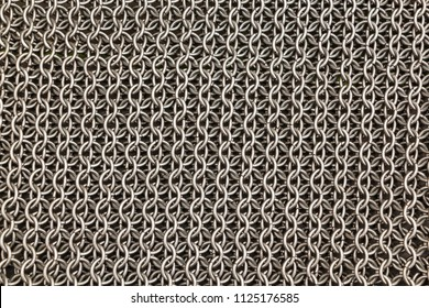 Medieval knight's armor mail frame. With flat rings that make chain slaves.Texture of chainmail of a medieval armor knight, Pattern, background, closeup, detail.