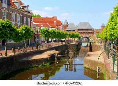 Medieval Koppelpoort, Eem river mirror reflections and classic city gate in Dutch old historic town Amersfoort, Holland