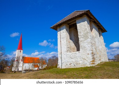 Medieval Lutheran church and bellfry in Kihelkonna, Saaremaa, Estonia. Spring sunny day. Landscape view.